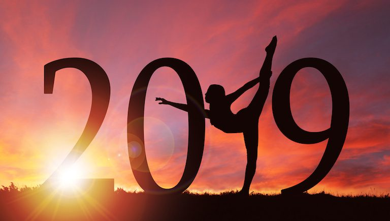 2019-yoga-pose-on-sunset-2019-wellness-trends-healthista.com-main-image-